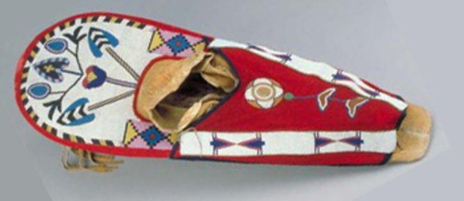 A beaded craddle board to wrap a child in tribal culture from birth